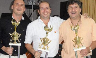 Fabricio Molinero (izq) junto a Claudio Dutto (der), presidente de la Federación fallecido recientemente.